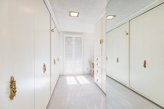 The master suite features an expansive walk-in closet.