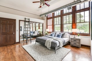Large windows allow ample light to flood into the bedrooms.