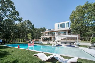 The surrounding grounds were re-landscaped to create even more privacy and garden views from the house, as well as around the tennis court and pools.