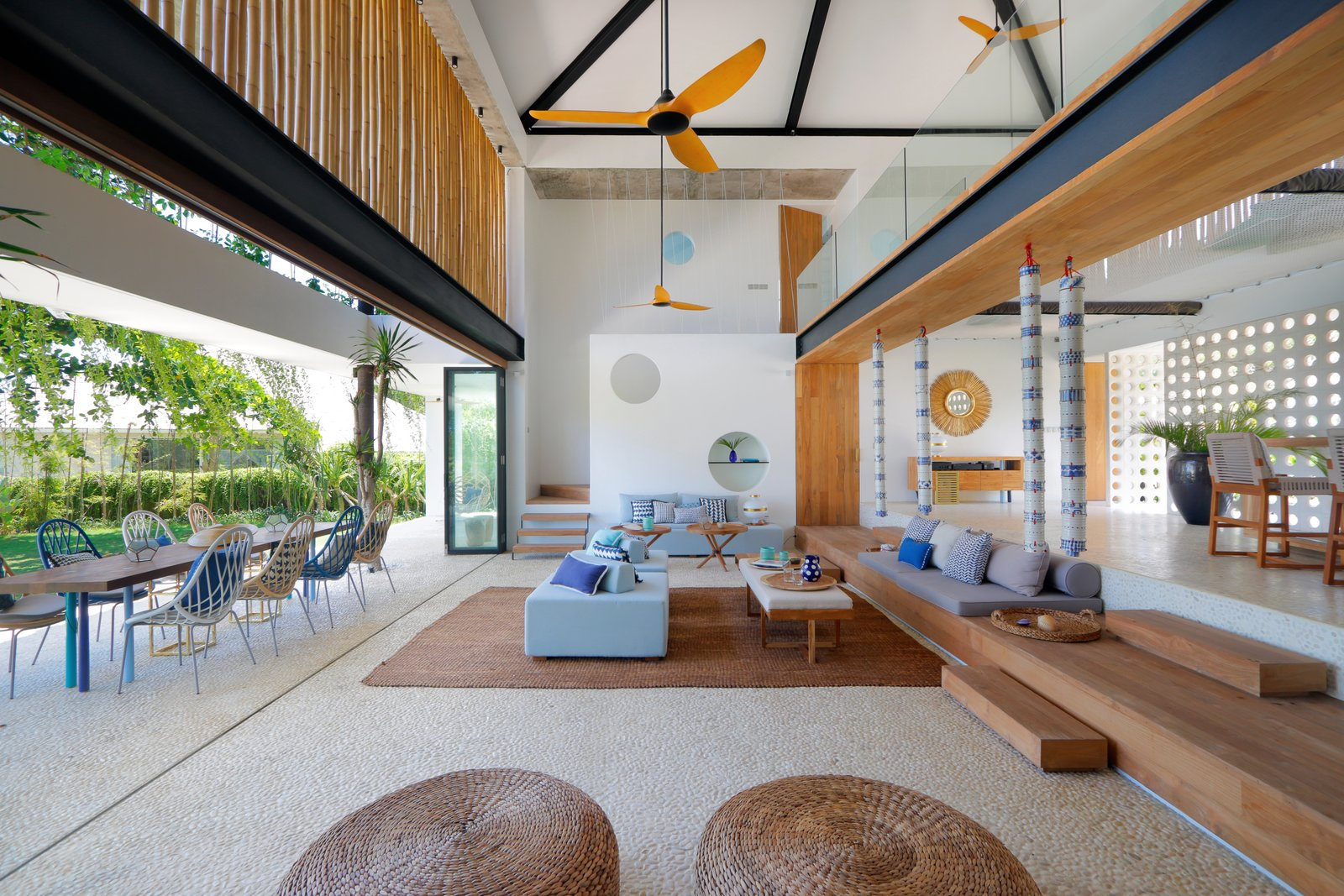 Living Room, Sofa, Chair, Ceiling Lighting, Bench, and Rug Floor  Photo 1 of 19 in Fall in Love With Bali at This Tropical, Modern Retreat