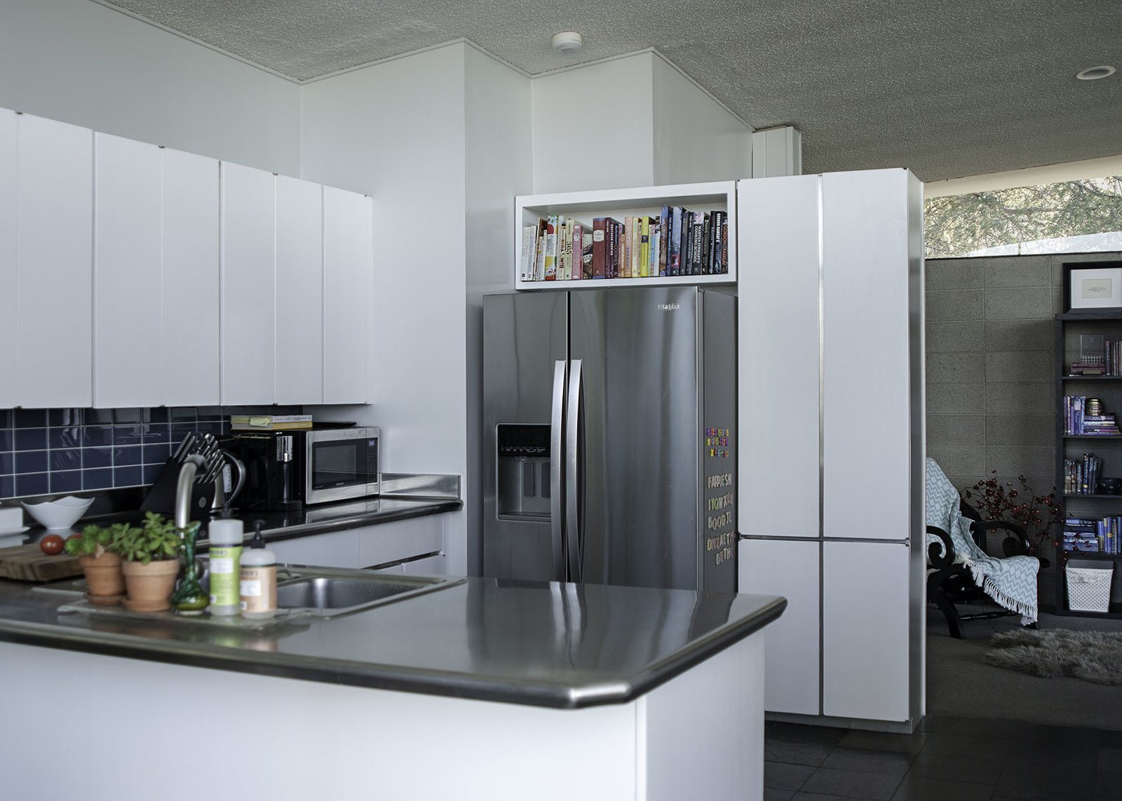 Kitchen, Refrigerator, Drop In Sink, Recessed Lighting, White Cabinet, Porcelain Tile Backsplashe, and Microwave The open kitchen has been recently updated.  Photo 6 of 13 in A 1958 Midcentury With Stunning L.A. Views Lists For $2.2M
