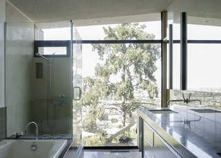 Even the bathrooms give a sense of being nestled into the surrounding nature.