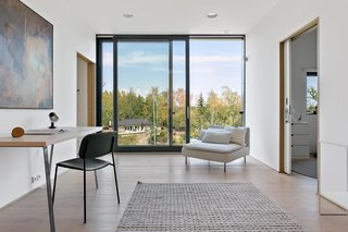 A look at the small sitting room with sliding doors to the exterior.