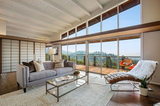 A wall of windows showcases the home's spectacular views of California's South Bay.