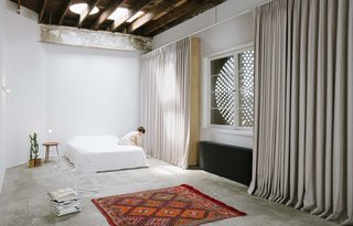 The general contractor's former office space was converted into a small apartment dwelling for the couple.
