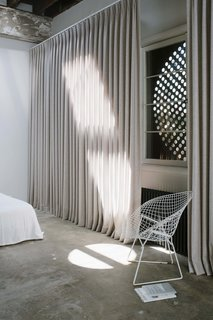 Cor-Ten steel shutters give the Little Space more security during long periods when the occupants are traveling.