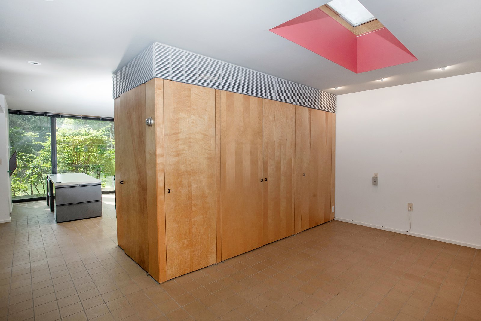 Storage Room and Closet Storage Type A skylight helps to further brighten the interior space.   Photo 6 of 9 in Own Legendary Designer Paul Rand's Midcentury Home For $895K