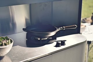 A stainless steel counter with two gas burners make outdoor cooking a breeze.