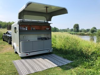 The Lume Traveler's kitchen is accessed from a rear hatch, similar to a teardrop trailer. There is also a 40-liter fridge below the counter that slides out as needed, and has plenty of storage for all your cooking supplies.