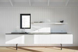 The simple white kitchen.
