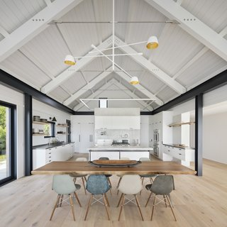 The neutral palette of the open-plan kitchen/dining feels polished and contemporary.