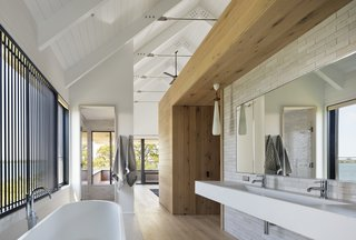 The wood also helps define the bathroom and add a sense of privacy in the space, which has largely been left open.
