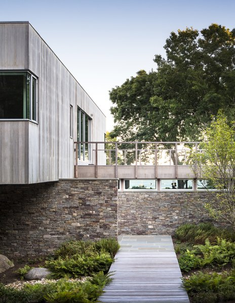 The mix of cedar and stone help integrate the dwelling into its natural setting.