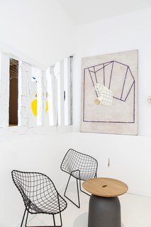 Bertoia Diamond Lounge Chairs work perfectly with the rotating collection of art.