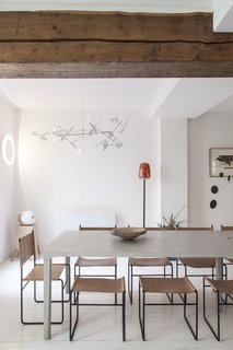 Exposed wooden beams add an element of warmth to the space.