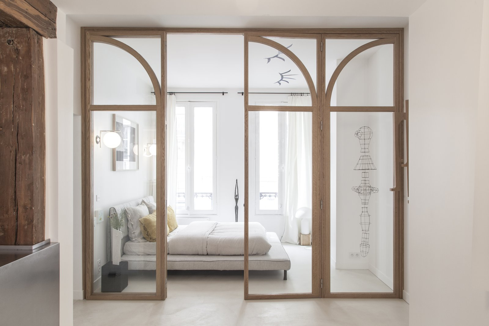 Bedroom and Bed A custom-made glass door has been integrated to maximize the natural light throughout.    Photo 6 of 14 in A Parisian Townhouse Is Reborn as a Luminous Art Gallery