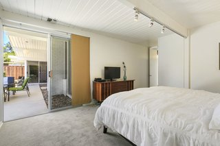 The roomy master suite has an ensuite bathroom and outdoor access.