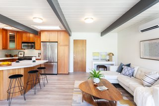 The kitchen also includes a sitting area, perfect for casual entertaining or family time.