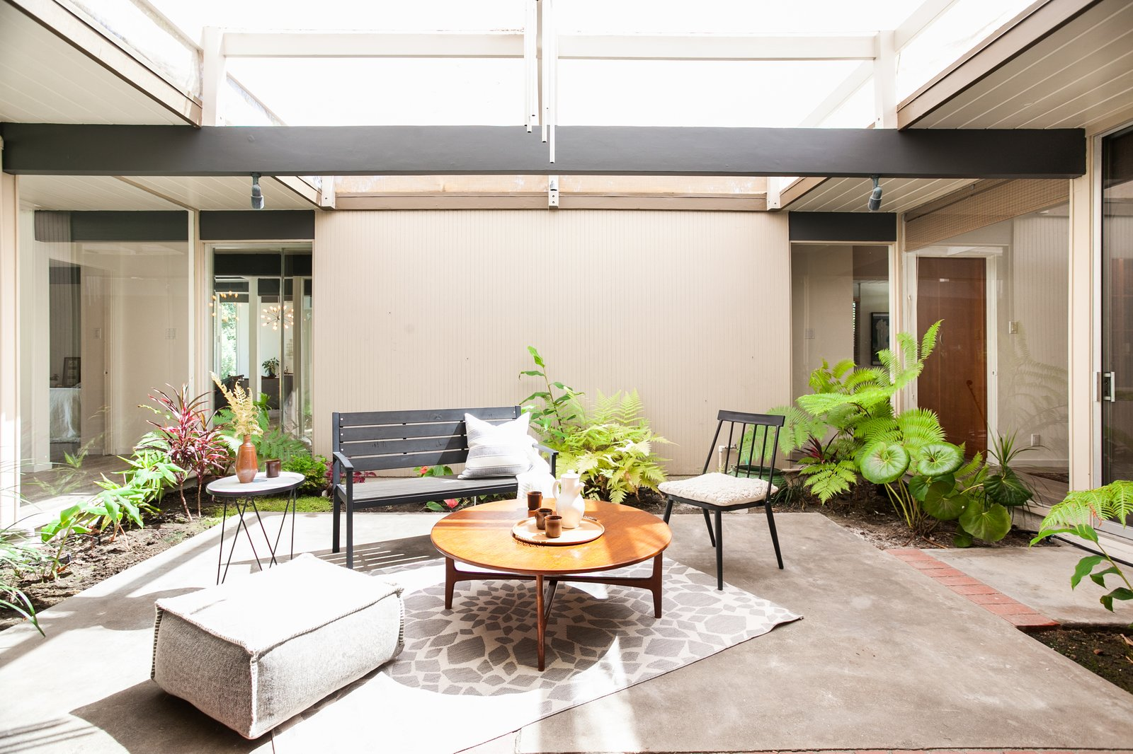The atrium sets the stage for the home's warm and welcoming feel.  Photo 3 of 15 in An Updated Orange County Eichler Hits the Market at $1M