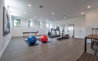 In the basement is a large bonus room with natural light that is perfect for a home gym, playroom, or office. There are two large ensuite guest rooms and a five-car garage with the possibility to expand the parking into the lower basement to accommodate a total of nine cars.
