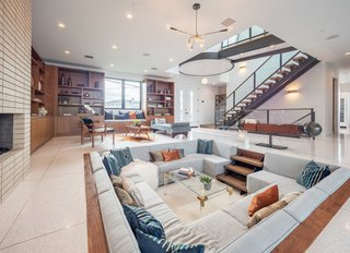 The ground level features an open floor plan with large-format terrazzo flooring.
