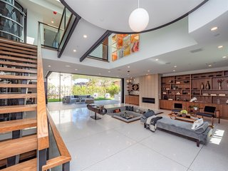 The living room opens to a covered patio, perfect for indoor/outdoor entertaining.