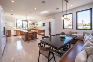 The kitchen also conveniently includes a dining area with built-in seating for casual entertaining or everyday use.