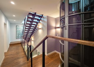 A floating staircases transports you from floor to floor—if you prefer, you can take the levitating, 52-inch cylindrical vacuum elevator.