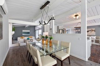 Here, you can see how the kitchen has been inserted into the center of the living space for easy entertaining.