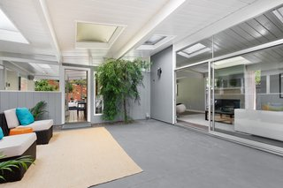The central atrium is bright and airy, infusing beautiful natural light throughout the home.