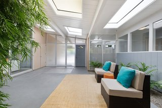 The front door brings you directly into the center atrium, providing a seamless transition between indoors and out.