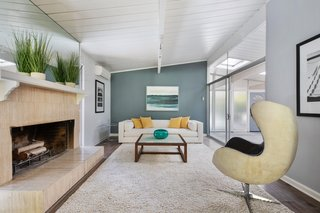 The spacious living room also receives ample natural light via the atrium.