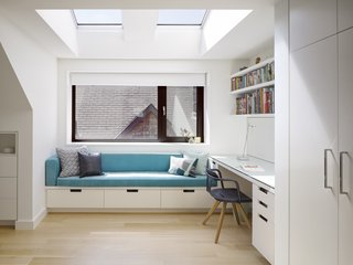 The second-floor bedrooms feature built-in office nooks with storage.