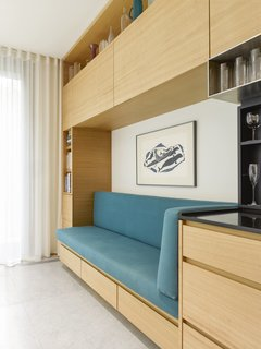 A close-up of the daybed and additional storage cabinets.