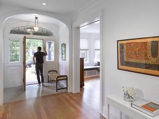 The grand stained-glass entry opens onto a central hall that stretches throughout the original part of the home that contains the living area and music room.