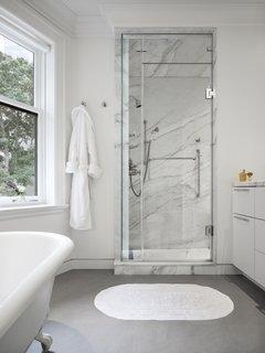 The master bedroom also has a marble-clad ensuite bathroom.