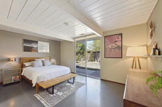 The large master bedroom features a walk-in closet and has direct access to the backyard.