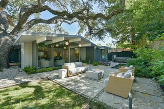 The newly landscaped yard is virtually maintenance free and features modern concrete hardscapes, as well as wood decking—perfect for alfresco entertaining.