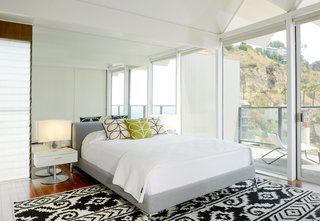 The bright and spacious master bedroom features sliding doors that lead to the terrace.