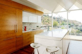 Wood paneling is set against the white cabinets and kitchen island.