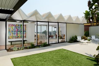 The courtyard has a serene sitting area and frames views into the house and straight through to the other side.