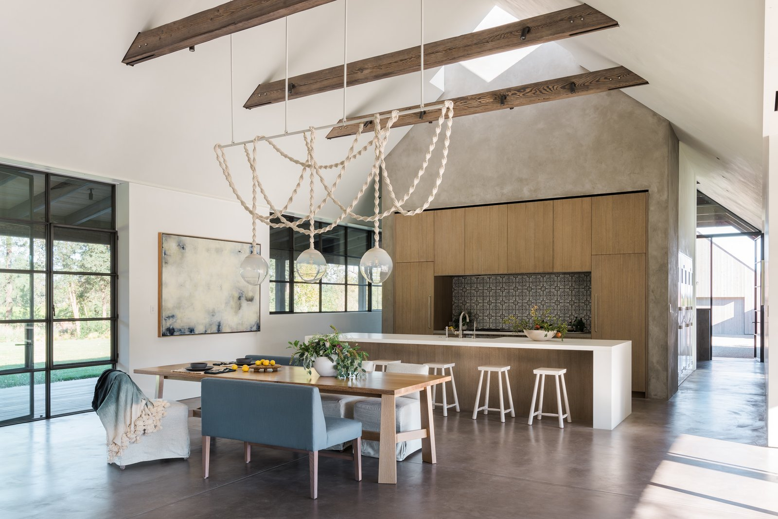 Dining, Table, Chair, Concrete, Storage, Stools, Pendant, Accent, Bar, and Bench  Best Dining Stools Accent Pendant Photos from A Barn-Inspired, Modern Retreat Is Knitted Into Napa Valley