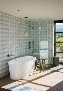 Windows allow natural light to filter into the space and also provide guests with views of the vineyard locale.
