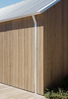 The attention to detail extends to the design of the home's streamlined contemporary gutters.