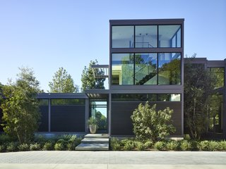 This custom residence for actor Will Arnett was inspired by LivingHomes' RK2 model. About a third was built on-site, including a glass staircase tower and a guest wing (featuring a recording booth where Will can ply his trademark baritone).