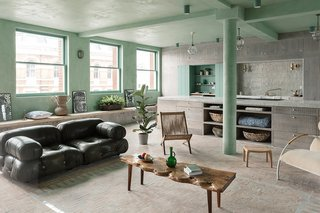 The patterned use of handmade Beldi tiles is used to delineate the space. The vintage olive-green leather sofa is from Mario Bellini Camaleonda.