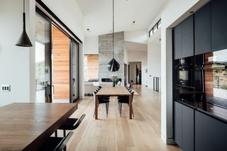 """Being from Denmark, the family knew that they wanted the home to have a Scandinavian touch. White walls, clean lines, and most importantly, touches of wood throughout keep things warm and inviting. """"This is a family home, not a cold art museum,"""" says Axboe. Light oak flooring was used throughout the main level."""