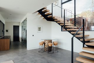 Stairs lead to a lower level family room, complete with a wine cellar.
