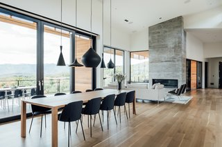 Tom Dixon's Beat pendant lighting hangs over the dining table.