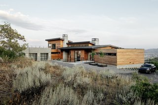 """The house was designed to seamlessly integrate into its surroundings. It is conceived as a """"looking box"""" to the mountain ranges, with ample outdoor decks and patios to enjoy the views."""